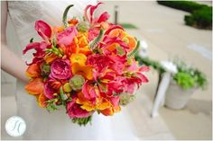 Romantic orange, hot pink and yellow bridal bouquet. Www.floralvdesigns.com