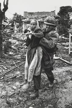 Don McCullin - A US Marine Chaplain helping an old Vietnamese woman</em>, 1968