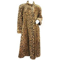 1980s Yves Saint Laurent Leopard Print Faux Fur Coat | From a collection of rare vintage coats and outerwear at http://www.1stdibs.com/fashion/clothing/coats-outerwear/