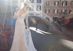 lovely lace sleeves and a pretty little belt on this wedding dress | Bridal Musings