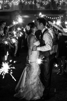 What a fun wedding sendoff! Create your own light for your wedding by giving your guests sparklers! {Hartman Outdoor Photography}