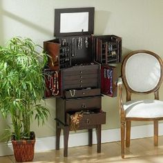 Southern Enterprises Cherry Jewelry Armoire.     Dimensions: 16 W x 11 D x 44.5 H    Finish: Cherry    Material: Solid Wood Legs / MDF with Veneer / PB with Veneer    Cherry Finish Jewelry Organizer Storage Armoire    If you are looking for a way to organize your large jewelry collection in     style, this rich cherry jewelry armoire is the solution.     Lift the top to reveal a large mirror, perfect for accessorizing.     The top section swings open to reveal racks to hang 50 pairs of…