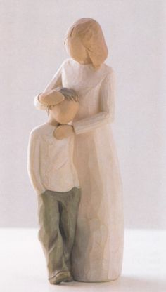 The love between mother and son comes across so clearly in this simple little figurine.