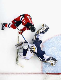 NEWARK, NJ - DECEMBER 29: Robin Lehner #40 of the Buffalo Sabres makes the save on Brian Boyle #11 of the New Jersey Devils at the Prudential Center on December 29, 2017 in Newark, New Jersey. The Sabres defeated the Devils 4-3 in overtime. (Photo by Bruce Bennett/Getty Images)