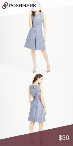 J.Crew Chevron-Striped Dress A classic fit-and-flare silhouette gets a new slant on stripes-- casted on chic chambray linen to create an easy, lightweight dress that's ready to take you from desk to dinner.  Finished with an inverted pleat in front and subtle peakaboo cutout in back, so it's a little bit sassy but totally classic.  Linen. Lined.  Back zip.  Machine washable. In size 000. J. Crew Dresses