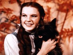 Reasons why I am more like Dorothy than any other character:  1. I love animals.  2. I trust too much and talk to just about anyone. And have been known to enter strangers trailers in the past.  3. I sing when I don't know how else to let my feeling out.  4. I dream of running away to a non-existant land.  5. I recently travelled Over the Rainbow and I'm currently residing there...if ya know what I mean... ;)