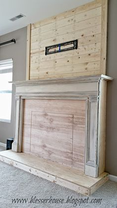 DIY faux fireplace with plank wall chimneypiece - Blesser House featured on Remo. : DIY faux fireplace with plank wall chimneypiece – Blesser House featured on Remodelaholic. Could add my floor to ceiling bookcases on either side. Faux Fireplace Mantels, Fireplace Wall, Mantles, Fireplace Ideas, Fireplace Outdoor, Limestone Fireplace, Open Fireplace, Fireplace Design, Diy Mantel