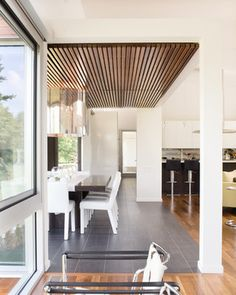 Bent/Sliced House - contemporary - Dining Room - Kansas City - Hufft Projects - floor, tile and hardwood