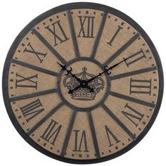 """Wood and canvas wall clock with a Roman numeral dial.   Product: Wall clock    Construction Material: Wood, canvas and metal    Color: Black and natural   Features:  Roman numeral dial   Will enhance any décor Dimensions: 26"""" Diameter x 2"""" D"""