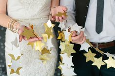 Gorgeous DIY star garlands - love these for a rehearsal dinner or engagement party!