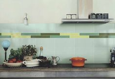 Green kitchen by Vogue ceramics.