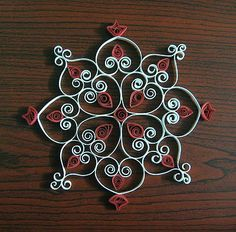 quilled kolam - southern india tradition