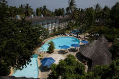 Travellers Beach Hotel Mombasa This 4 star hotel is located in Bamburi Beach, 10km from the centre of Mombasa. It features a large lagoon-style outdoor pool and 4 restaurants.