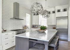 White and gray kitchen. Kitchen with white perimeter cabinets and gray kitchen island. #Kitchen Melodie Hayes.