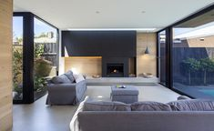 Contemporary two-story house located in Port Melbourne, Australia, designed in 2018 by Thomas+Williams Architects. Fireplace Feature Wall, Fireplace Stores, Fireplace Redo, Cedar Walls, Open Concept Home, Long House, Melbourne House, Two Story Homes, Waterfront Homes