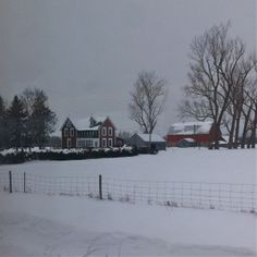 Eastern Ontario farmhouse and barns in the winter as seen from the Via Train, between Brockville and Ottawa,