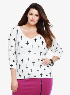 Dolman sleeves, sheer drop needle stripes and a wide V-neck give this effortless white sweater a cool, relaxed look. For an edgy finish, we added an allover cross print.