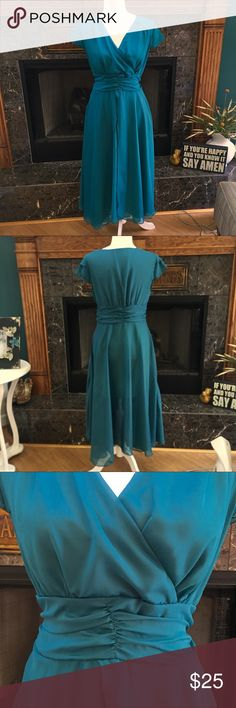 """NWOT Teal Chiffon Maxi Dress Very pretty and feminine flowing dress. Pics make color look blue but it's definitely a teal color. Has side zipper and short lining underneath skirt. Outer skirt is sheer. Size says large but fits more like a medium. I bought it on Poshmark and it didn't fit... pooo!! Measurements are laying flat armpit to armpit 18"""" waist 14.5"""" hips approx 19"""" and length is 49"""" from shoulder to bottom hem. And from shoulder to shoulder is a bit over 15"""". Dresses Maxi"""
