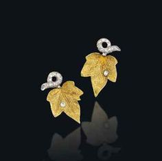 A PAIR OF DIAMOND-SET IVY LEAF EAR CLIPS, BY CARTIER. Very detailed.