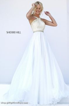 Gorgeous chiffon gown with beaded bodice. 74 East Main St. Buford GA 30518 Phone: 770-831-8795