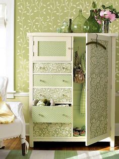 Darling refurbished armoire anchors this home's living space by echoing the color scheme determined by the wallpaper and furnishings. Its combination of drawers and closet space offers the perfect solution for small-space storage. Refurbished Furniture, Repurposed Furniture, Furniture Makeover, Painted Furniture, Decoupage Furniture, Armoire Makeover, Wardrobe Makeover, Fabric Covered Furniture, Recycling Furniture