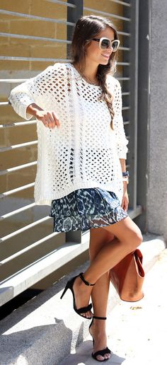 Jessie Chanes is wearing a crochet mesh top from Zara, skirt from Vila, sandals from Mango and a bag from Su-Shi