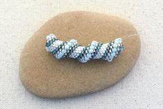 Cellini spiral is a variation of tubular peyote stitch made with different sized beads. Learn Cellini spiral stitch with this beading tutorial.