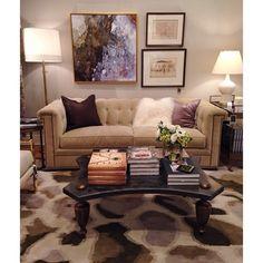 alice lane home collection, velvet tufted sofa, stone coffee table, crystal artwork, gold floor lamp, white lamp