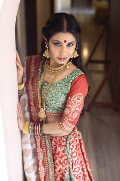 BRIDALWEAR by Ayush Kejriwal A red vintage benarsi Lengha with 1920s inspired hand zardozi work and a classic choli and odhni.