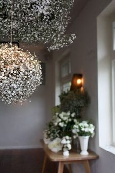 "Baby Breath Balls(Gypsophillia/Gyp)-Hang a foam ball that had been soaked. Make little 'bunches'of gyp, packing them in tightly. Stick double prong wire into foam ball starting at the top n working down. Approx 10/15 full bunches=100-200 little 'bunches'of gyp to go onto foam ball. ""Double prong wire technique is to bend wire into staple down stems, wind wire around stems twice n pull down to create two wires pointing down, in line with the stem."""