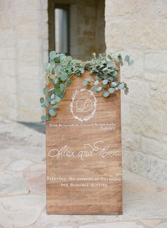 Welcome your wedding guests with a wood calligraphy sign.