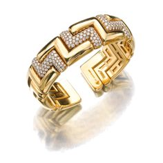 SOTHESBY'S MAGNIFICENT JEWELS ~ Gold and diamond bangle, Bulgari
