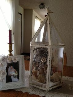 Preserved wedding bouquet in our lantern. http://www.facebook.com ...