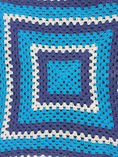 This crochet baby blanket is 32 X 32 and made from 100% cotton yarn. This blanket gets softer the more its washed and is the perfect size for your new little one. Featuring charcoal gray, a vibrant yellow and teal it is the perfect color scheme to compliment any nursery. This