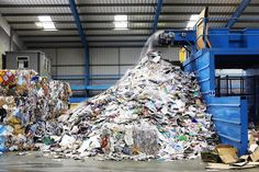 waste falling on pile from conveyor belt at recycling factory Recycling Plant, Paper Recycling, Recycling Bins, Printer Ink Cartridges, Recycling Facility, Glass And Aluminium, Ways To Recycle, Reuse, Companies In Dubai