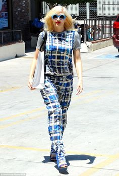 Get your ne-on: Gwen sported a pair of bright neon blue sunglasses to shade her eyes...