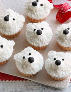 Made with sweet fondant icing and delicious desiccated coconut, these cute polar bear cupcakes make the perfect Christmas treats to share with friends and family - and they take just half an hour to make! | Tesco