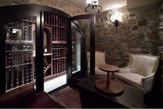 Wine Cellar and Tasting Room - a single wall behind glass and a lounge style tasting area