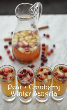 Pear + Cranberry Winter Sangria I would do white rum instead of dark and champagne instead of sparkling water
