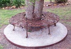 welded metal art bench | old tools welded to make tree bench