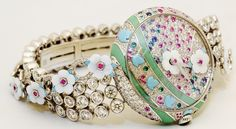 #Faberge timepiece of diamonds, rubies, emeralds, sapphires, Persian turquoise, malachite & mother of pearl...#OhMy