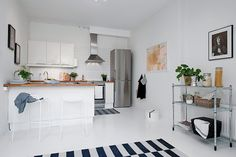 Kitchen with Hee barstools from Hay via Nordic Days.
