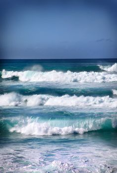Blue Waves by Laura Bellamy ... I'm always astonished at how very BLUE tropical waters can get. These particular waves were captured in Oahu, and they're much higher than they may appear. Absolutely awesome!