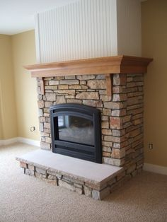 wrap around fireplace mantel. Fireplaces  Masonry and Exterior Remodeling for Traverse City Hoopfer Enterprises Wrap around mantel Fireplace Remodel Pinterest Mantels