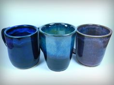 Valerie Zoz. The first one on the left is two coats of Obsidian followed by two coats of Indigo Float. Middle, two coats of Obsidian and then three coats of Seaweed on the top half. The one on the right is two layers of Blue Midnight with two layers of Smokey Merlot over it. Glazes For Pottery, Pottery Mugs, Pottery Ideas, Ceramic Pottery, Pottery Art, Clay Mugs, Ceramic Clay, Earthenware, Stoneware