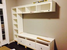 Materials: Hemnes Bookcase, Hemnes Bridging Shelf, Hemnes TV Bench Based on some other Ikea hacks, we used a Hemnes TV bench, bookcase, and bridging shelf to create an awesome entryway for our house.