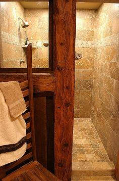small walk in shower framed with wood beam log . love this for spare boys shower Walk in shower entry. No glass door, Love the natural cleanliness and low upkeep this would require. Occasional mopping, and polishing of the faucets and that's it. Rustic Master Bathroom, Rustic Bathroom Designs, Rustic Bathrooms, Dream Bathrooms, Bathroom Ideas, Master Shower, Bathroom Vanities, Bathroom Showers, Shower Ideas