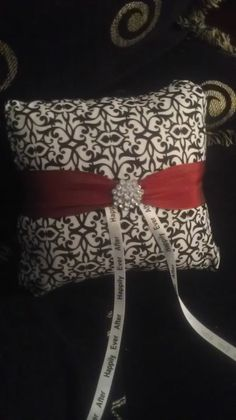 #DIY ring bearer pillow, I think I will just get a white pillow and make the ring ribbons a thinner red ribbon    #wedding #ringbearerpillow