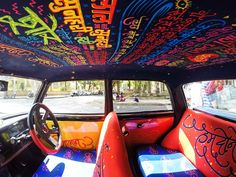 Text scribbled on the top of a taxi cab in Mumbai India. Incredible artwork.