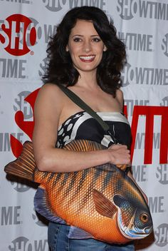 PAGET BREWSTER, March 10th, 1969. PISCES. Emily on CRIMINAL MINDS. Note the fish shoulder bag!! Good Pisces!!